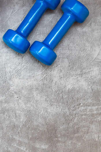 Blue Table High Angle View Indoors  Still Life No People Close-up Two Objects Group Of Objects Wood - Material Textured  Healthcare And Medicine White Color Day Medium Group Of Objects Simplicity Weights Document Dumbbell Medicine