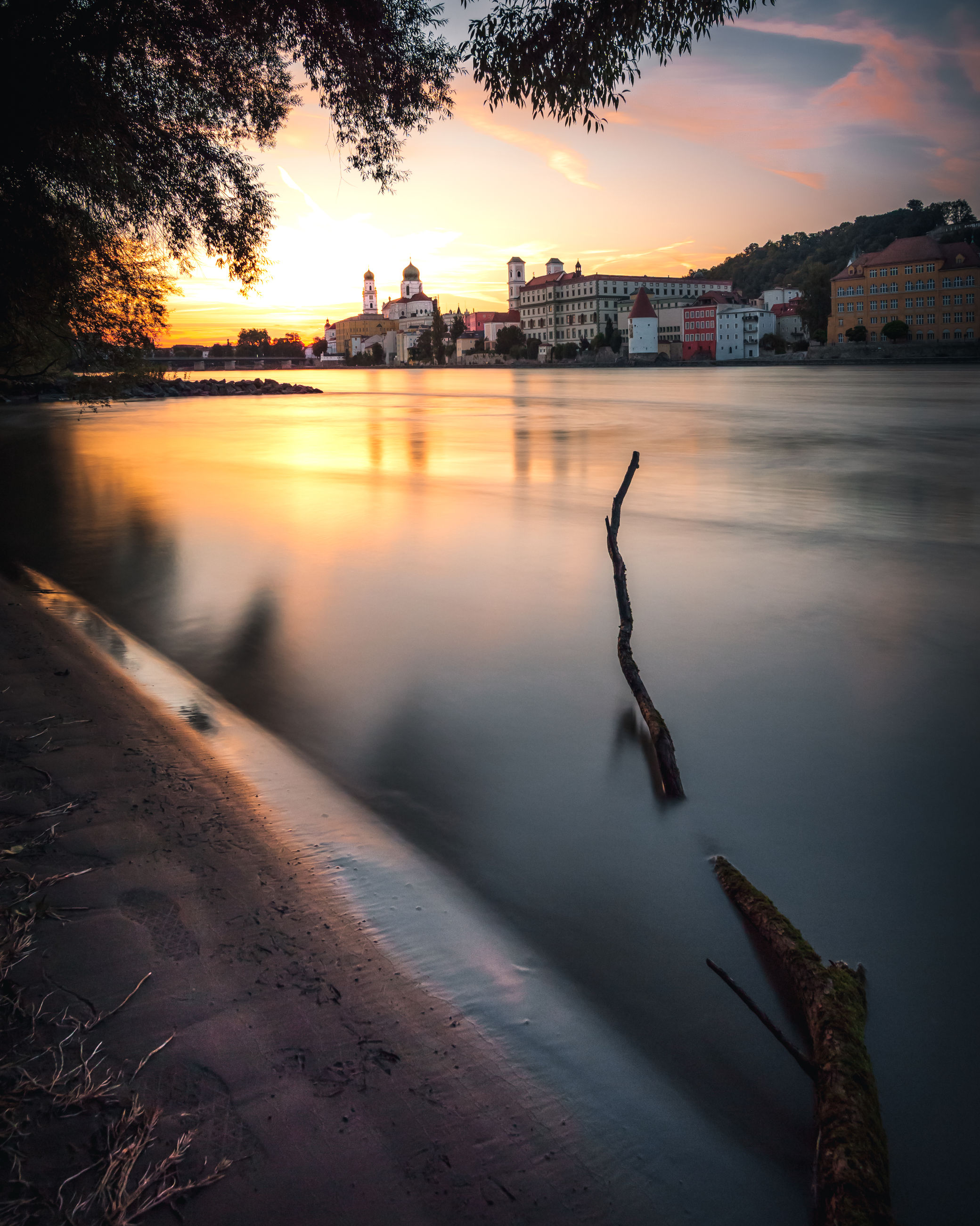 water, sunset, architecture, sky, built structure, building exterior, nature, reflection, river, cloud - sky, long exposure, orange color, building, beauty in nature, no people, city, outdoors, travel destinations, scenics - nature