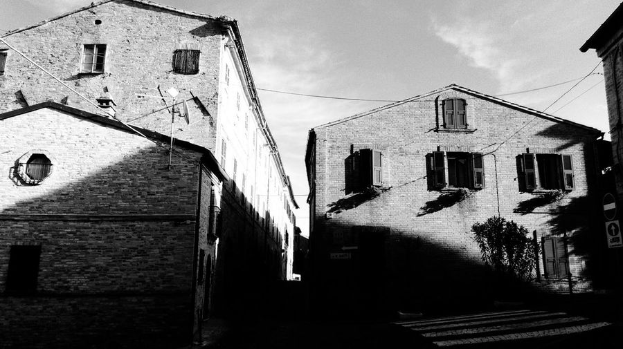 Building Exterior Architecture Built Structure Sunlight Low Angle View Outdoors No People Sky Day City Light Light And Shadow The Soul Historical Building Old Buildings Building My Point Of View My Favorite Place Montecosaro Travel Destinations Architecture Solitude