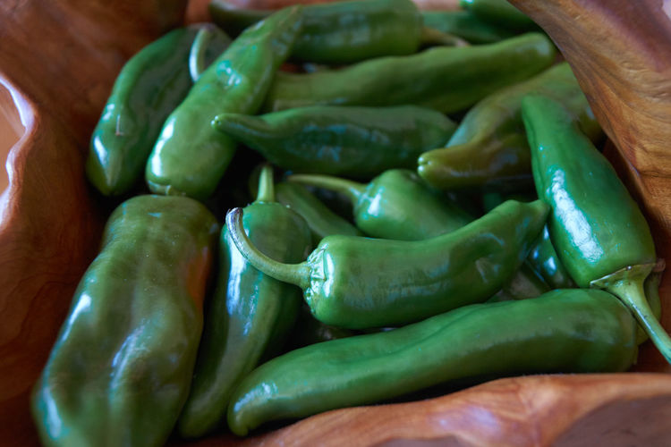 Close-up of green chili peppers in market