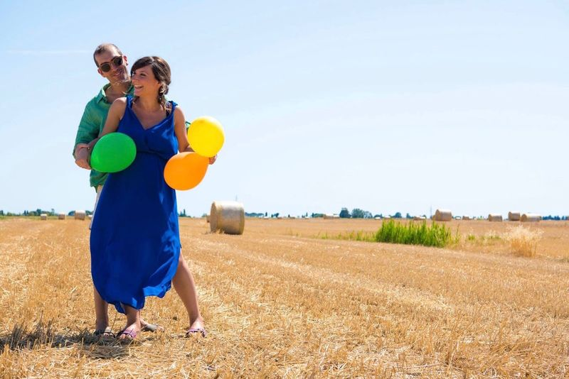 Happiness Adult Smiling Men Fun Happiness Summer People Enjoyment Field Women Cheerful Beauty Sky Two People Beautiful People Togetherness Rural Scene Agriculture Adults Only Married Balloons Field Couple Pregnancy Pregnant Phtography