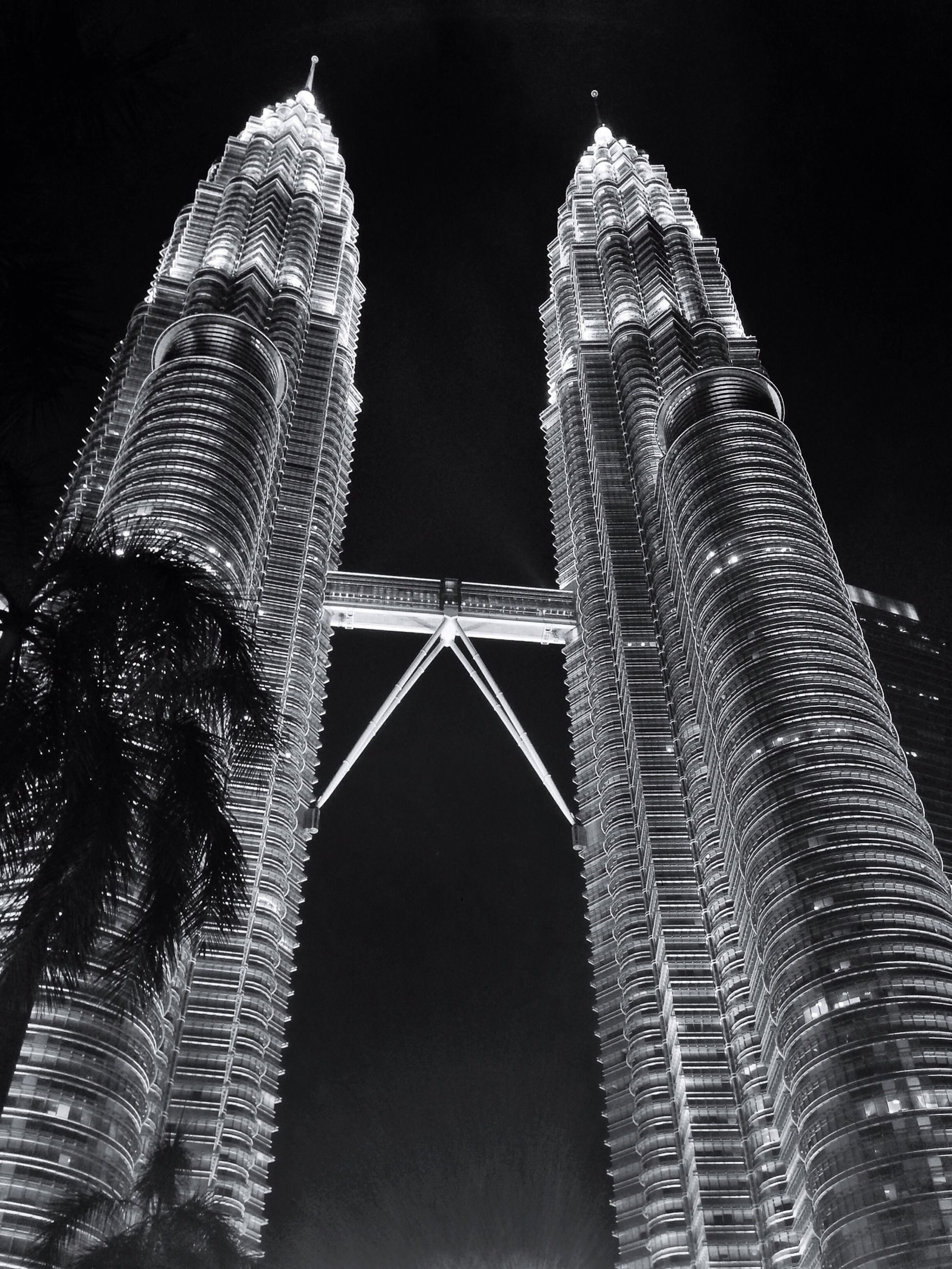 architecture, built structure, famous place, building exterior, international landmark, low angle view, travel destinations, night, capital cities, tourism, tall - high, travel, city, tower, clear sky, modern, skyscraper, reflection, sky, outdoors