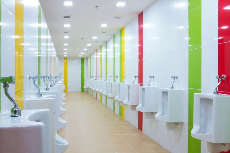 Colorful toilet with urine bowls. EyeEm Selects In A Row Indoors  Absence No People Empty Seat Architecture Flooring Ceiling Repetition White Color Building