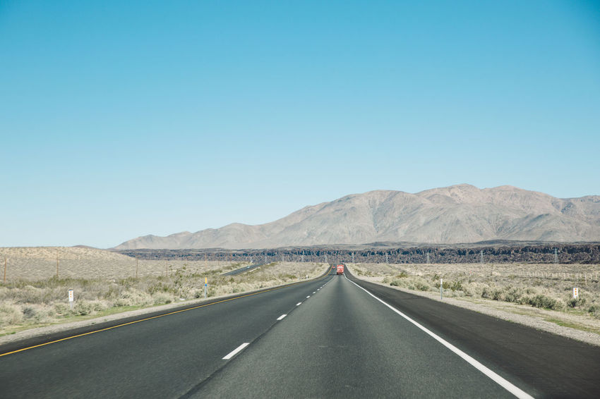 Arid Climate Arid Landscape Asphalt Blue Sky CA-190 California Clear Sky Coso Day Death Valley Desert Empty Landscape Mountain Mountain Range Nature Nature Outdoors Road Road Road Marking Roadtrip The Way Forward Transportation White Line