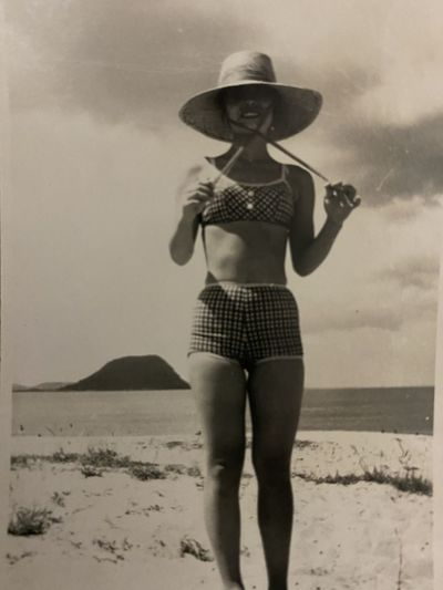 Full length of a woman standing on beach