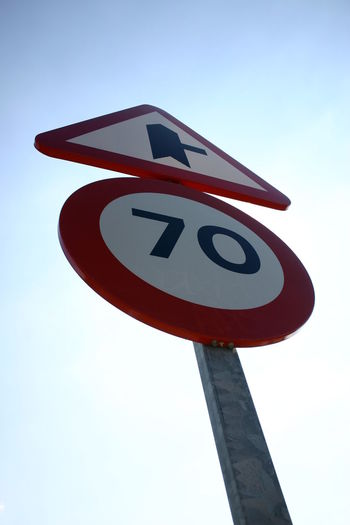 Traffic 70 70 Limited SPAIN Road Sign Communication Guidance Low Angle View Warning Sign Red Day Outdoors No People