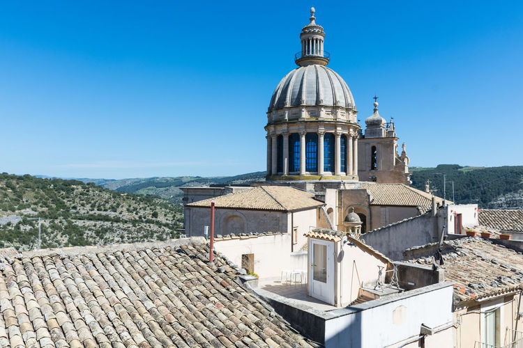 Ragusa - Scorcio Italiano Ragusa Ibla, Sicily Sicily Sicily ❤️❤️❤️ Sicily, Italy Travel Architecture Building Exterior Built Structure Clear Sky Day Dome Mountain No People Outdoors Place Of Worship Ragusa Ragusa Ibla Ragusaibla Religion Roof Sky Spirituality Tiled Roof  Travel Destinations