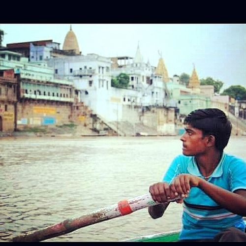 Oarman on the Ganges India Amazing India  Aroundtheworld Travel Photography Photography Portrait Portraiture Ganges River Rowing Varanasi Profile Boat Morning Holy Young Man Ganges River Human Humaninterest Humans Of Earth
