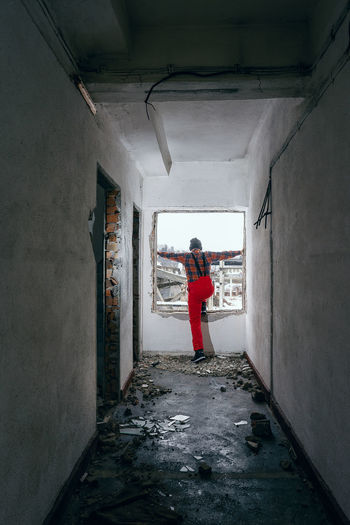 Before marriage. Red Rear View Jumping Corridor Hallway Damaged Ruins Work Equipment Damaged Architecture One Person Window Man One Man Only People Full Length Men Architecture Built Structure Entry Light At The End Of The Tunnel Building Bad Condition Entrance Hall Passageway Deterioration Abandoned Interior