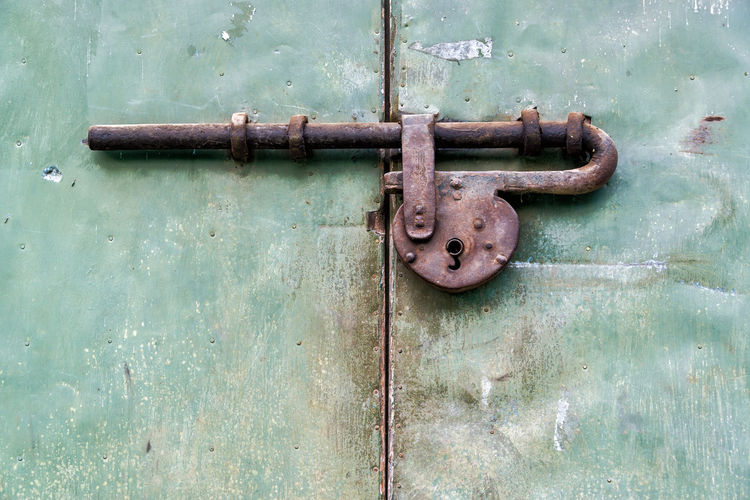 Old historic lock on a door in Mompox, Colombia Close-up Closed Colombia Colombian  Deterioration Door Green Historic Lock Magdalena River Metal Metallic Mompos Mompox  Old Padlock Protection Rio Magdalena Rust Rusted Rusty Safety Security Traditional Weathered