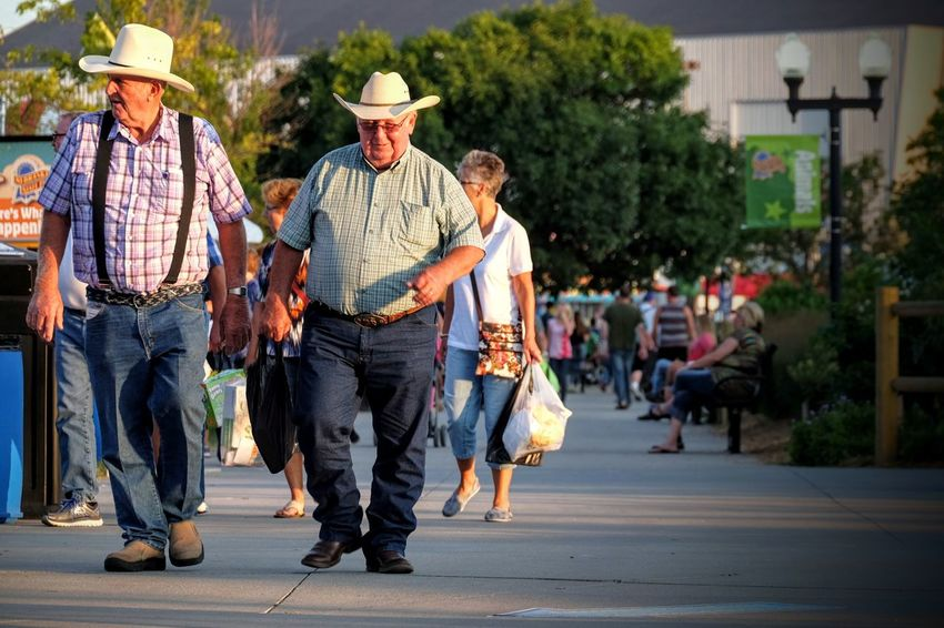 Nebraska State Fair August 2016 Grand Island Nebraska America Americans Camera Work City Life Cowboy Hat Cultures Eye For Photography EyeEm Best Shots EyeEm Gallery Fairground Farmers FUJIFILM X-T1 Full Length Lifestyles Mature Men Nebraska Outdoors Photo Essay Photojournalism Real People Selects Small Town Stories State Fair Streetphotography Walking