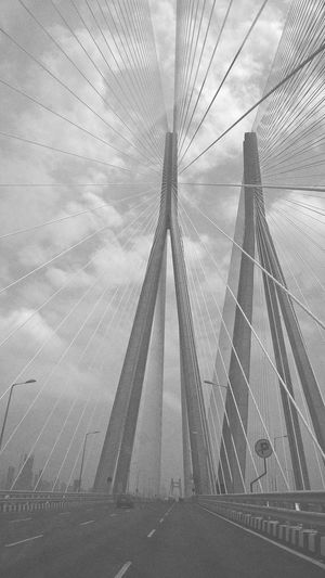 Masterpiece of structural engineer Engineering Technology Highway Strings Gray Cloud - Sky Outdoor Photography Outdoors Daylight Metal Structure Mumbai India Blackandwhite Photography Backgrounds City Sky Cloud - Sky Suspension Bridge Engineering Steel Cable Bridge Cable-stayed Bridge Bridge - Man Made Structure Iron Bolt Tall - High Underneath Elevated Road
