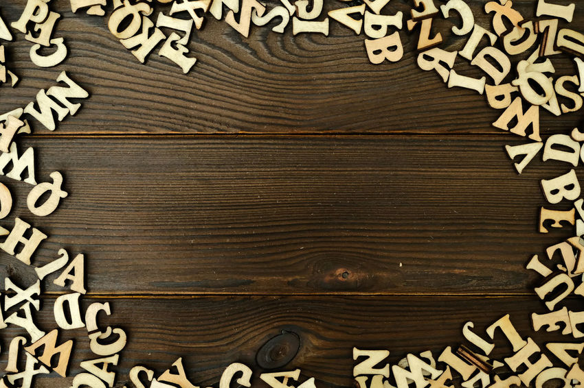 WOODEN ALPHABET WITH COPU SPACE ON CENTER Art And Craft Backgrounds Black Color Brown Close-up Communication Design Directly Above Floral Pattern Full Frame Income Tax Return Indoors  No People Non-western Script Paper Pattern Script Table Text Textured  Textured Effect Wood Wood - Material