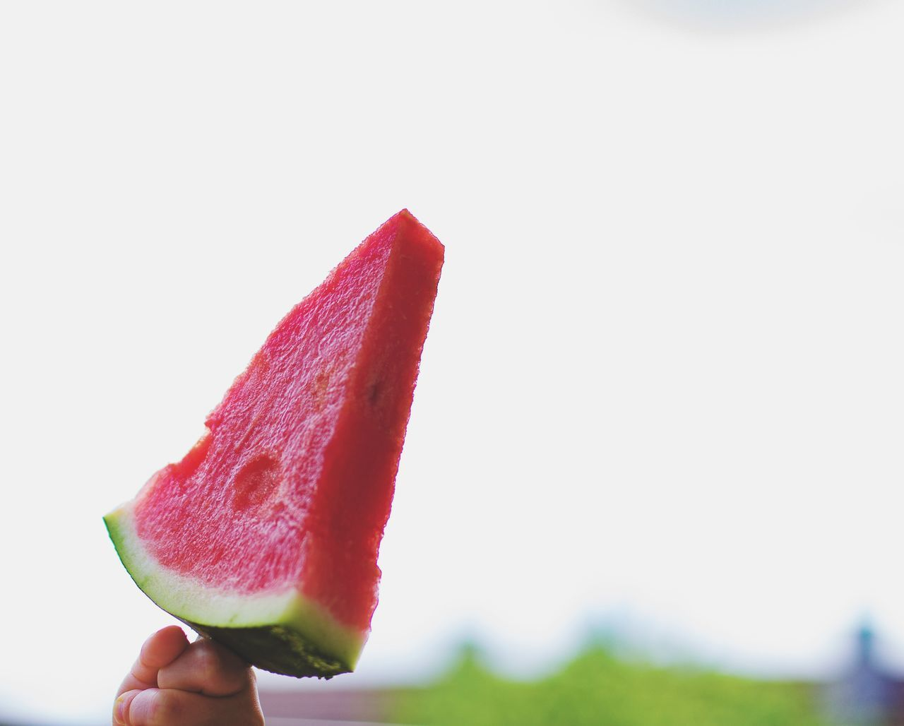 food and drink, holding, watermelon, freshness, slice, one person, copy space, food, fruit, human hand, real people, healthy eating, flavored ice, clear sky, lifestyles, refreshment, red, healthy lifestyle, frozen food, human body part, close-up, women, outdoors, ice cream, day, white background, ready-to-eat, people