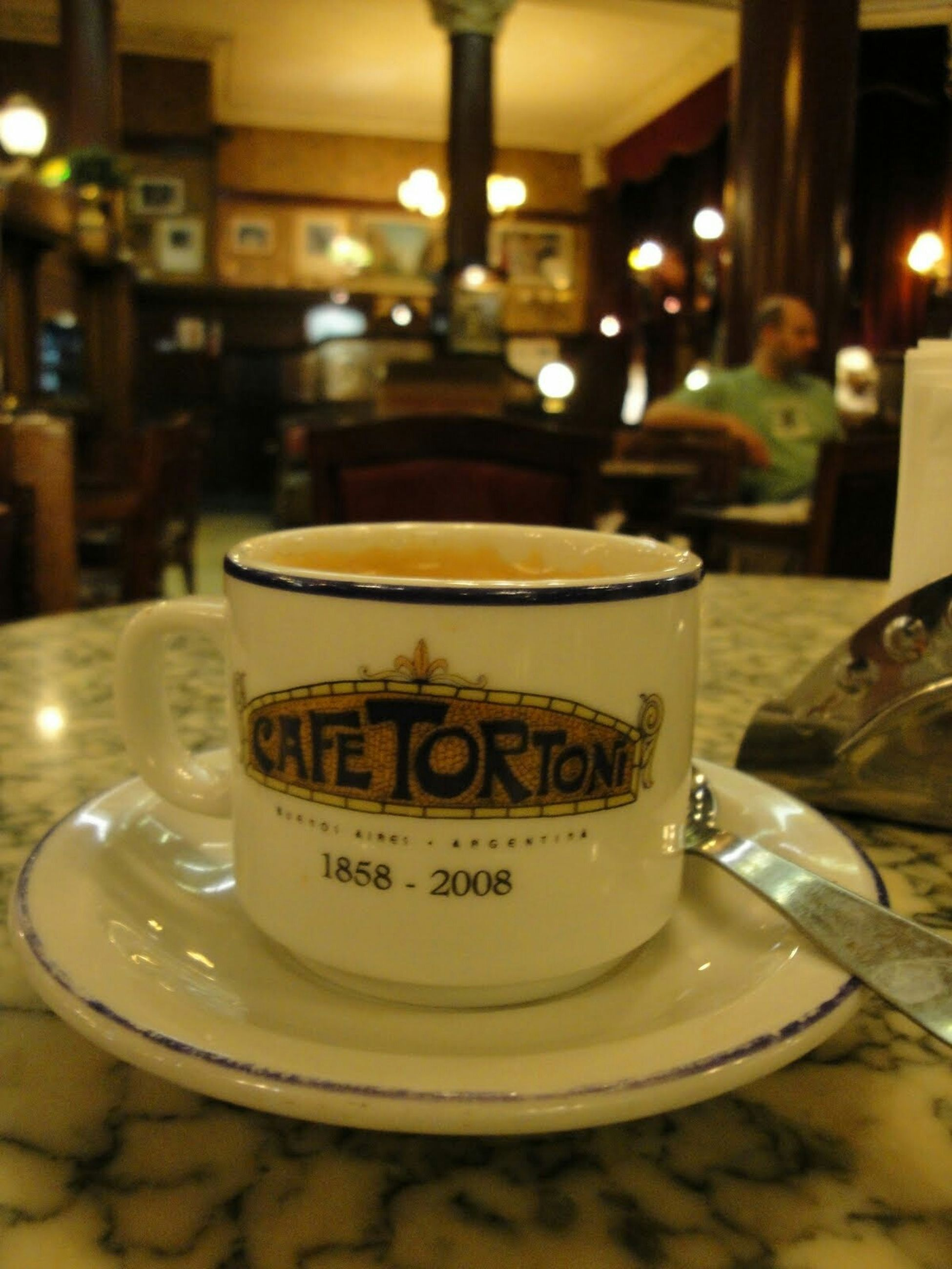 indoors, food and drink, drink, text, table, communication, focus on foreground, western script, close-up, refreshment, still life, restaurant, coffee cup, illuminated, cafe, coffee - drink, selective focus, freshness, incidental people, no people