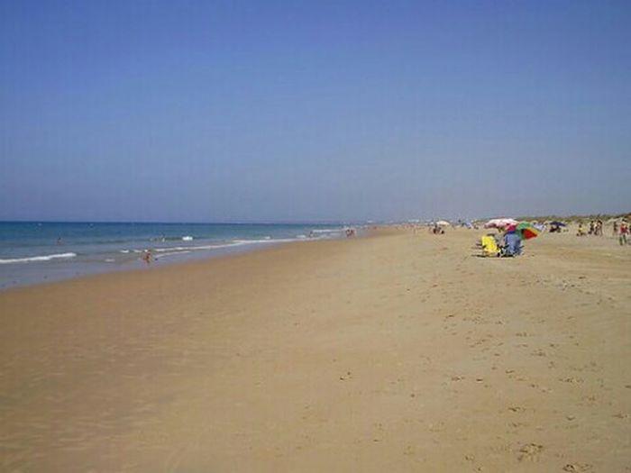 Playa del Palmar. Beach Sand Sea
