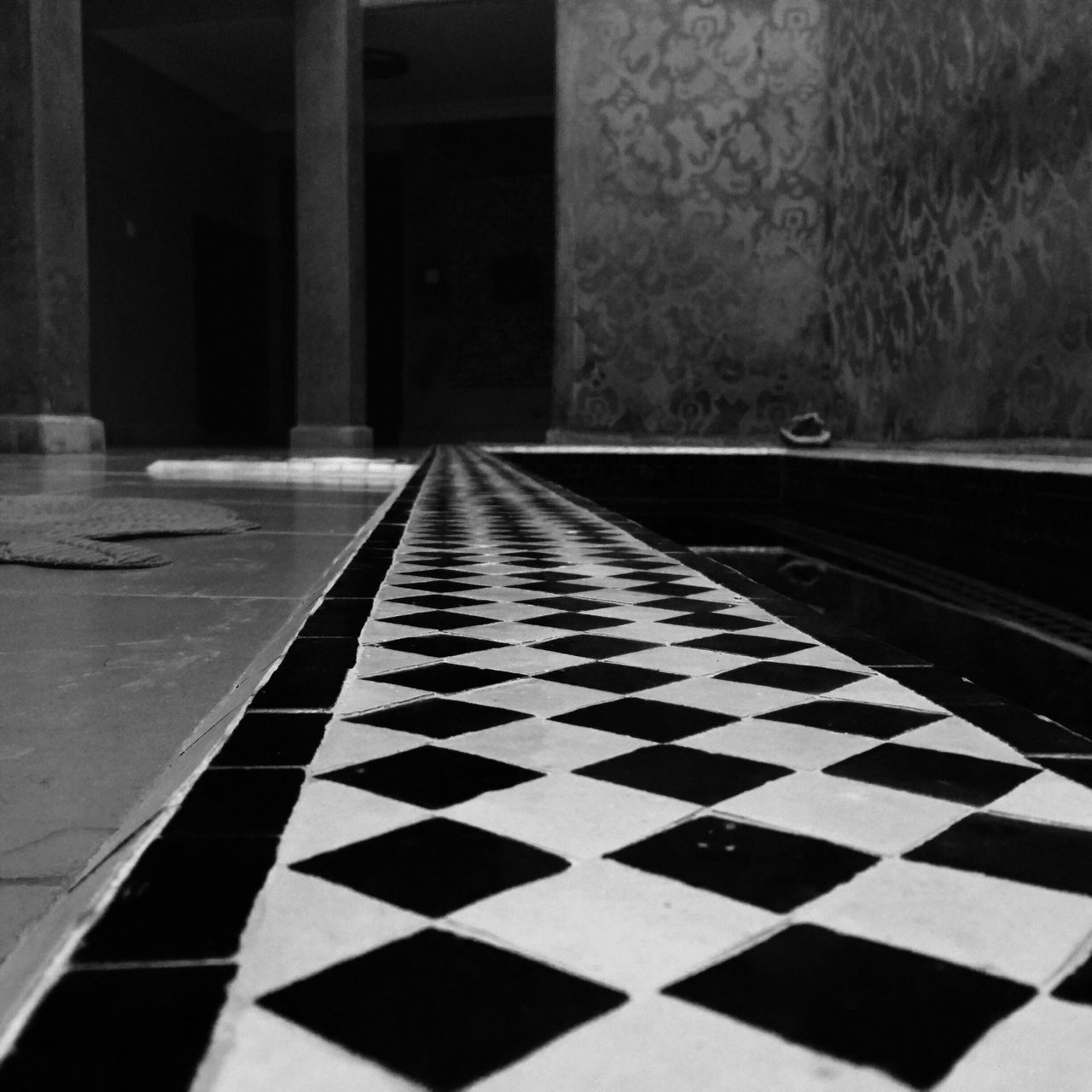 checked pattern, chess, chess board, indoors, chess piece, leisure games, square shape, pattern, no people, black color, strategy, competition, challenge, close-up, day