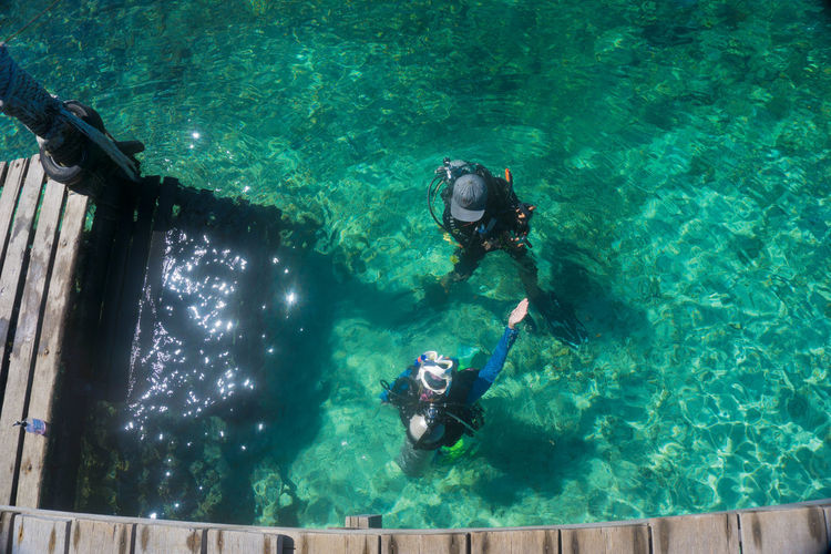 High angle view of scuba divers in sea