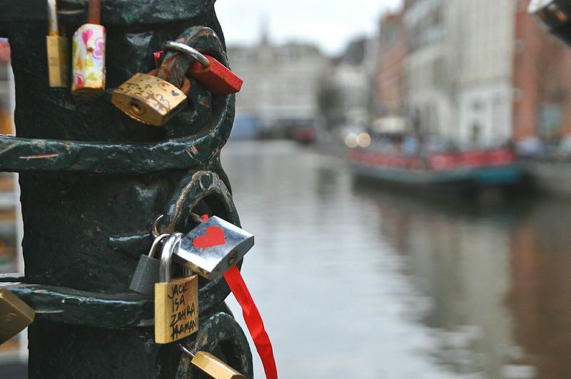 Locks of love on a bridge in amsterdam city with the canals in the background Your Amsterdam Locks Bridge Love Canals Symbol Of Amsterdam My Amsterdam Water Ways Amsterdam Netherlands Amsterdam Canal City Of Amsterdam Typical Amsterdam Welcome To My World Amsterdamcity Canals Of Amsterdam City Life My Hometown Cityscape