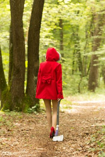 Rear View Of Fashion Model Walking In Forest