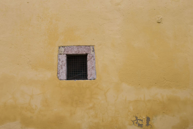 Window in a yellow wall Asturias Copy Space Horizontal Rural SPAIN Abandoned Architecture Backgrounds Building Exterior Colorful Day Full Frame Geometric Shape No People No People, Old Pillarno Spring Sunlight Wall - Building Feature Window Yellow