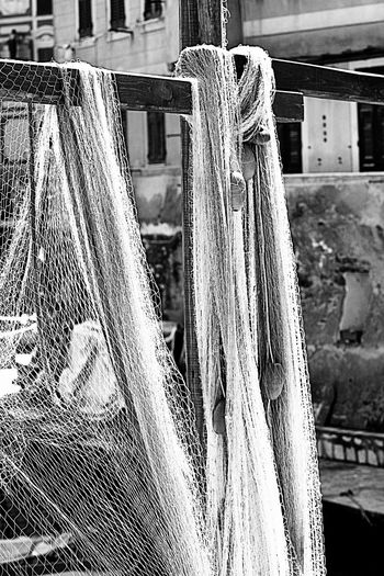 fishing nets sprawled out to dry in the sun in the harbor of Camogli, Italy, village fisher on the Ligurian coast Camogli,Italy,Liguria Close-up Day Drying Equipment Fisher Village Fishing Fishing Net Focus On Foreground Hanging Harbor Italy🇮🇹 No People Object Outdoors Port Rope Texture Wharf Wood - Material