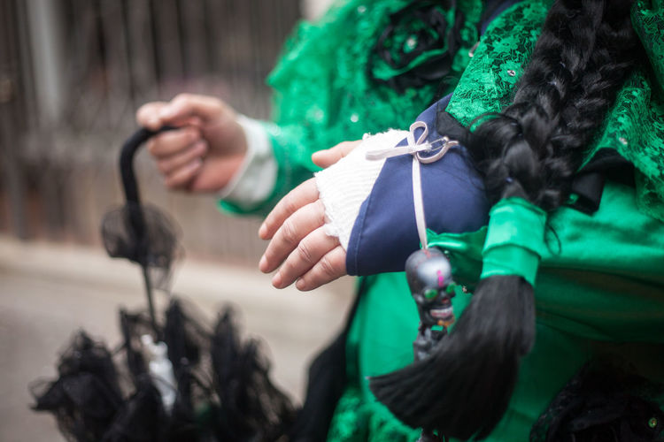 Midsection of women in green costume