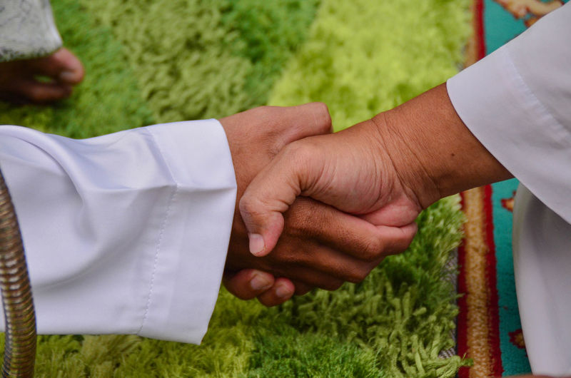 Close-Up Of People Shaking Hands