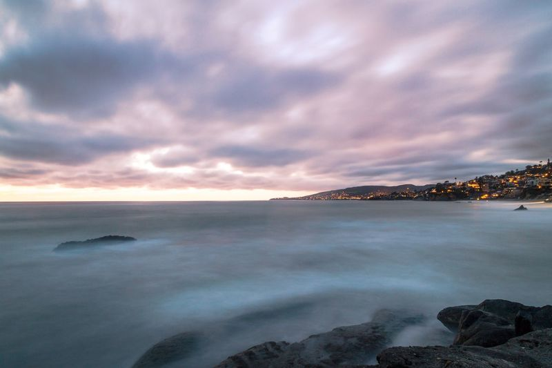 "Laguna Beach Series - Long Exposure: Treasure Island 4 As a reminder, the photos from this series were taken in a part of Laguna Beach, called ""Treasure Island"". For this shot, I used a Formatt Hitech Filters Firecrest Soft Edge Grad ND 0.9 filter and exposed the shot for 41 seconds. Sea Nature Sky Beauty In Nature Scenics Water Tranquil Scene Tranquility Cloud - Sky No People Sunset Outdoors Beach Horizon Over Water Sunset And Clouds  Adventure Long Exposure ND Filter Longexposurephotography Longexposure Beachphotography Sunsets Sunset_collection Landscape Travel Destinations The Great Outdoors - 2017 EyeEm Awards"