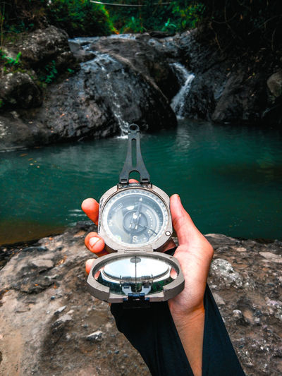 Adventure Compass Day Exploration Finger Geology Hand Holding Human Body Part Human Hand Leisure Activity Lifestyles Nature One Person Outdoors Personal Perspective Real People Rock Rock - Object Solid Unrecognizable Person Water First Eyeem Photo