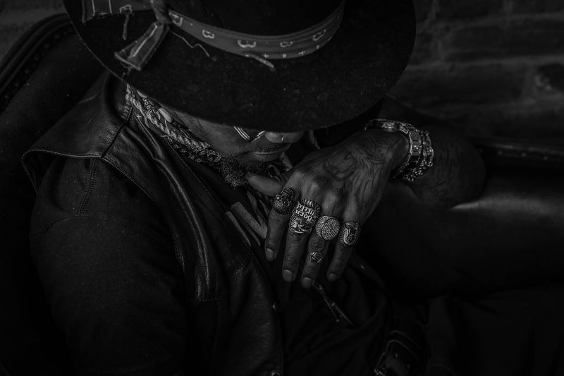 High angle view of man wearing rings and tattoos