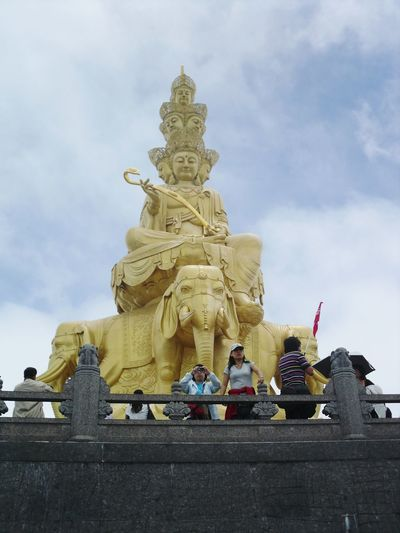 Four face Buddha on Mount Ermei, China. Trip Photo China Mount Emei Four Face Buddha Tourist Attraction  Day Golden Statues And Monuments Religious Statues