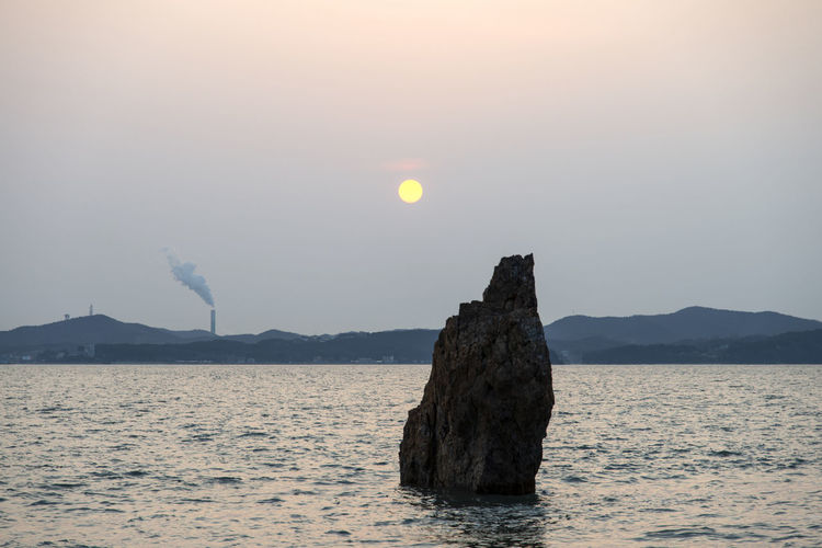 sunset at Daebudo Island in Gyeonggido, South Korea Daebudo Daebudo Island Tranquil Tranquility Beauty In Nature Idyllic Mountain Nature No People Non-urban Scene Outdoor Outdoor Photography Outdoors Rock Rock - Object Scenics - Nature Sea Seaside Sky Solid Stack Rock Sun Sunset Tranquil Scene Tranquility Water Waterfront