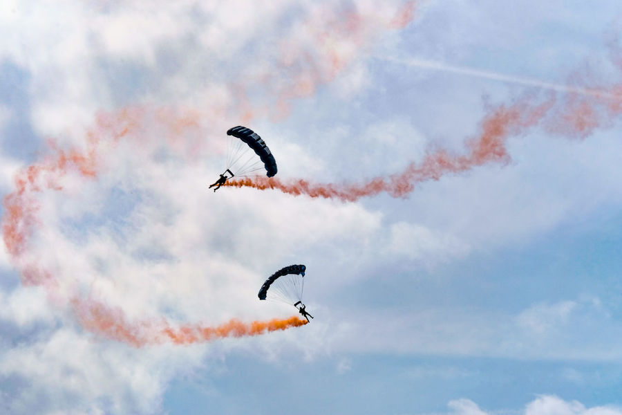 The Tigers Parachute Display Team in action at the Clacton-on-Sea Airshow 2017. Clacton-on-Sea Essex Essex Sunshine Coast Smoke Tigers Parachute Display Team Clouds Day Outdoors Parachute Sky