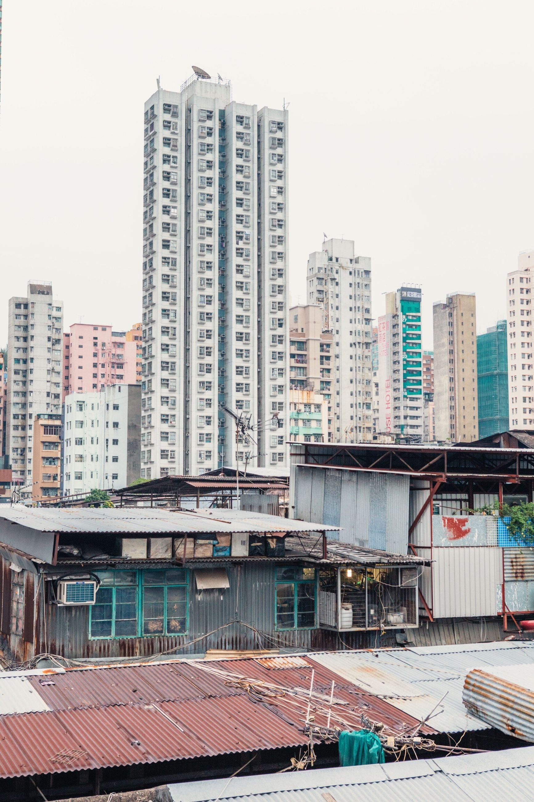 architecture, building exterior, built structure, city, roof, residential structure, residential building, tall - high, residential district, tower, skyscraper, apartment, sky, office building, outdoors, tall, city life, day, development, no people, architectural feature, urban skyline, building story