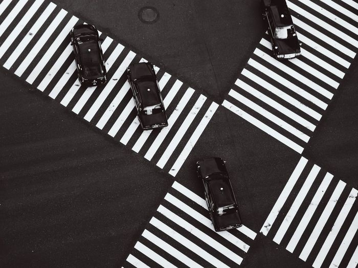 Tokyo Tokyo Street Photography City Crossing Crosswalk Day High Angle View Low Section Marking One Person Outdoors Real People Road Road Marking Shadow Sign Street Striped Sunlight Symbol Transportation Walking Zebra Crossing