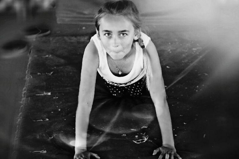 Portrait of girl practicing push-ups