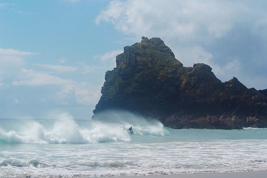 Surfs up Sea Nature Beauty In Nature Sky Rock - Object Scenics Water Waterfront Day Outdoors Cloud - Sky Power In Nature Wave Motion One Person Horizon Over Water People Surfing Kynance Cove Cornwall Uk England