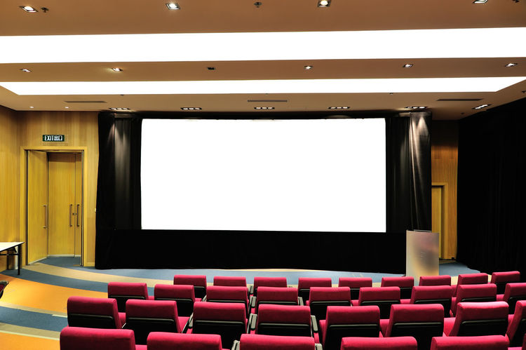 Arts Culture And Entertainment Auditorium Chair Empty Film Industry Indoors  MOVIE Movie Theater No People Projection Screen Seat Stage - Performance Space