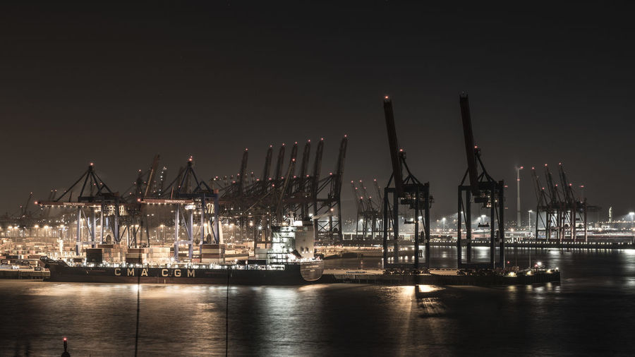 Industry Water Machinery Harbor Transportation Freight Transportation Commercial Dock Architecture Crane - Construction Machinery Shipping  Pier Illuminated Business Nautical Vessel Waterfront Unloading Night Sky Reflection No People Outdoors