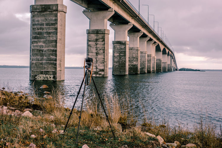 Architecture Beauty In Nature Bridge - Man Made Structure Built Structure Camera - Photographic Equipment Connection Day Horizon Over Water Nature No People Outdoors Photography Themes Sea Sky Water