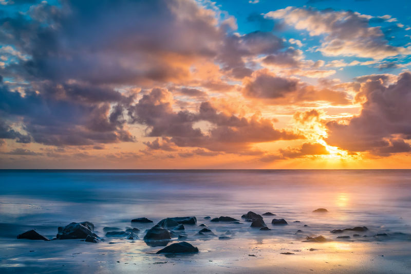 Scenic View Of Seascape At Sunrise