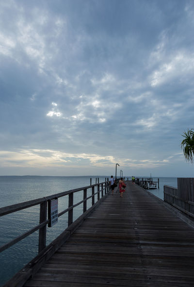 Gone fishing. Pier on Frasier Island, Australia Cloud - Sky Fisherman Fishing Horizon Over Water Jetty Nature Outdoors People Pier Railing Sea Sky Sunset The Way Forward Tranquil Scene Tranquility Water Wood Paneling