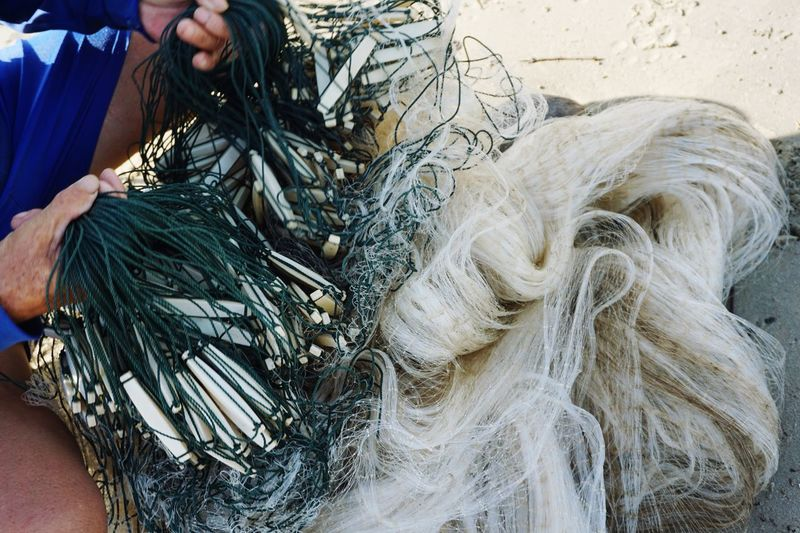 Pukat One Person Human Body Part Fishing Net Human Hand Fishing Industry Real People Working Fishing Commercial Fishing Net Occupation Hand Holding Adult Midsection Day Body Part Textile Men Art And Craft Fisherman