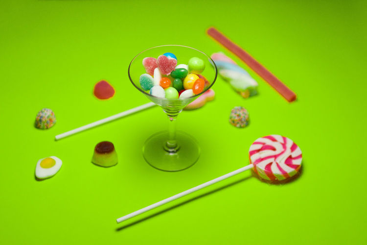 Candy Celebration Colored Background Food Food And Drink Freshness Fruit Green Background Green Color Indoors  Indulgence Lollipop Multi Colored No People Still Life Studio Shot Sweet Sweet Food Temptation Unhealthy Eating