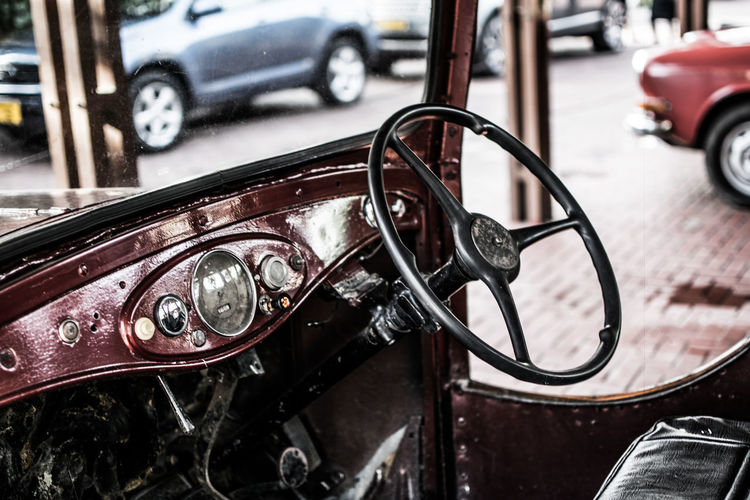 vintage car City Bicycle Land Vehicle Yellow Taxi Car Street Stationary Close-up Architecture Vintage Car Collector's Car Steering Wheel Speedometer Car Interior City Street Dashboard Windshield