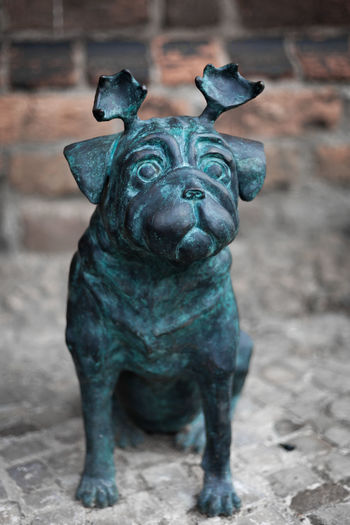 """This tiny buddy comes from the birthplace of the famous humorist Loriot and is called a """"Waldmops"""" in english it might be a """"wood pug dug"""" because of the very special horns. Shot taken @ Brandenburg an der Havel, 2017-06-24 Still Life Mops Brandenburg An Der Havel Pug Statue Waldmops Animal Representation Animal Themes Close-up Day Loriot No People Outdoors Pug Dog Sculpture Sculptures Statues Statues/sculptures"""