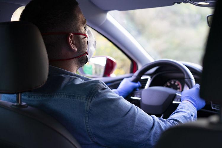 Portrait of man sitting in car