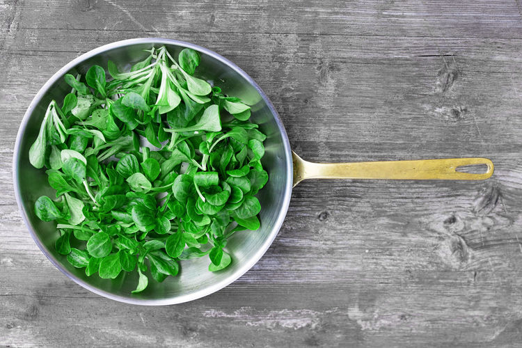 Close-Up High Angle View Of Leafy Vegetables In Pan