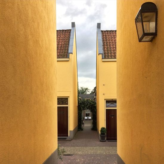 Architecture Building Exterior Built Structure Building Yellow Outdoors Residential Building Day City Sky